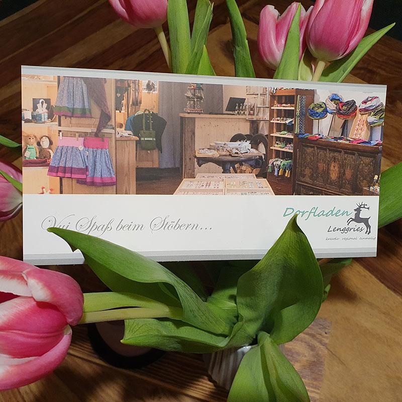 Gutschein dekoriert mit rosa Tulpen